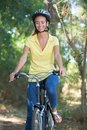 Joyful girl traveling with bike in forest Royalty Free Stock Photo