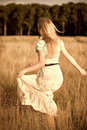 Joyful girl walking on a field Stock Images