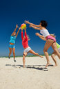 Joyful girls playing volleyball Royalty Free Stock Photo