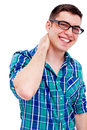 Joyful guy with hand on neck closeup portrait of young man his isolated white background Royalty Free Stock Photo