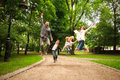 Joyful happy family in summer park together jumping have fun Royalty Free Stock Photo