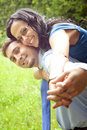 Joyful happy young couple playing outdoor Royalty Free Stock Photo