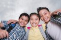 Joyful hugging kids portrait of looking at the camera view from below Royalty Free Stock Images