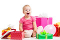 Joyful kid girl with colorful balloons and gifts Stock Image