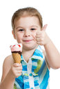 Joyful kid girl eating ice cream in studio isolated Royalty Free Stock Image