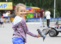 Joyful little girl with a dove on hand feeding birds seeds Stock Image