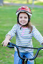 Joyful little girl riding a bike Royalty Free Stock Photo