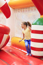 Joyful little girl on a trampoline playing Royalty Free Stock Photos