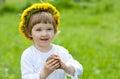 Joyful little girl in yellow chaplet Stock Photo