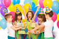 Joyful little kid girl receiving gifts at birthday Royalty Free Stock Photo
