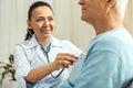 Joyful nice doctor doing medical examination