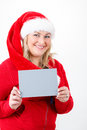 Joyful pretty santa woman with empty sign Stock Photography
