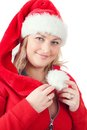 Joyful pretty woman in red santa claus hat smiling Royalty Free Stock Photo