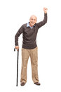 Joyful senior gesturing with his hand full length portrait of a in the air isolated on white background Stock Photos