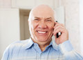 Joyful senior man speaking by mobile portrait of handsome Royalty Free Stock Photography