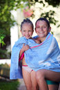 Joyful siblings wrapped in a towel after swimming Royalty Free Stock Images
