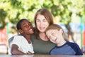 Joyful single parent with sons at park table