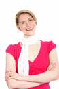 Joyful stylish blond woman standing with her arms folded smiling happily at the camera isolated on white Stock Photo