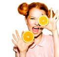 Joyful teen girl with funny red hairstyle juicy oranges Stock Photo