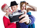 Joyful teenage friends with photo camera Royalty Free Stock Photography