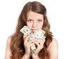 Joyful teenage girl with dollars in her hands Stock Photo