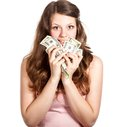 Joyful teenage girl with dollars in her hands Royalty Free Stock Photo