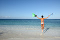 Joyful woman in bikini runs to the sea Stock Photos