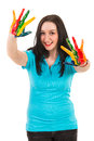 Joyful woman with colorful hands cheerful showing in paints isolated on white background Stock Image
