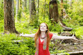 Joyful woman in forest Stock Photos