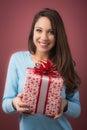 Joyful woman with gift box beautiful young holding a red ribbon Stock Photo