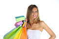 Joyful woman makes shopping on white background Royalty Free Stock Images