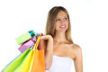 Joyful woman makes shopping on white background Stock Image