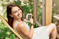 Joyful woman using cell phone Royalty Free Stock Photo