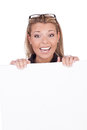 Joyful woman with white board Stock Images