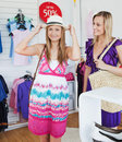 Joyful women choosing clothes together Stock Photo
