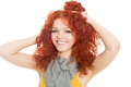 Joyful young girl with red hair holding his head in his hands Stock Photography