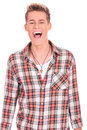 Joyful young man yelling Royalty Free Stock Photos