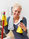 Joyful young woman cleaning your house Stock Photos