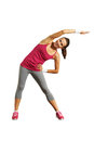 Joyful young woman doing exercises over white background Royalty Free Stock Photos