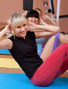 Joyful young women working out Stock Image