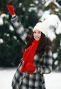 Joyfully young woman in winter hands up Stock Images