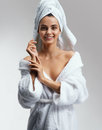 Joyous attractive girl in white bathrobe after spa. Royalty Free Stock Photo
