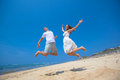 JOYOUS COUPLE ON BEACH Stock Images