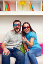 Joyous couple d glasses watching comedy laughing Royalty Free Stock Photos