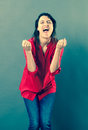 Joyous 30s woman shouting with euphoric body language Royalty Free Stock Photo