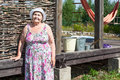 Joyous senior woman standing near house wall Royalty Free Stock Photo