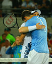 Juan Martin Del Potro R congratulates Olympic champion Andy Murray of Great Britain with his victory at men`s singles final Royalty Free Stock Photo