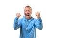 Jubilant man cheering and punching the air Royalty Free Stock Photo