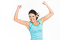 Jubilant young woman rejoicing raising her fists in the air with a triumphant smile Royalty Free Stock Photos