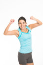 Jubilant young woman rejoicing raising her fists in the air with a triumphant smile Royalty Free Stock Photo